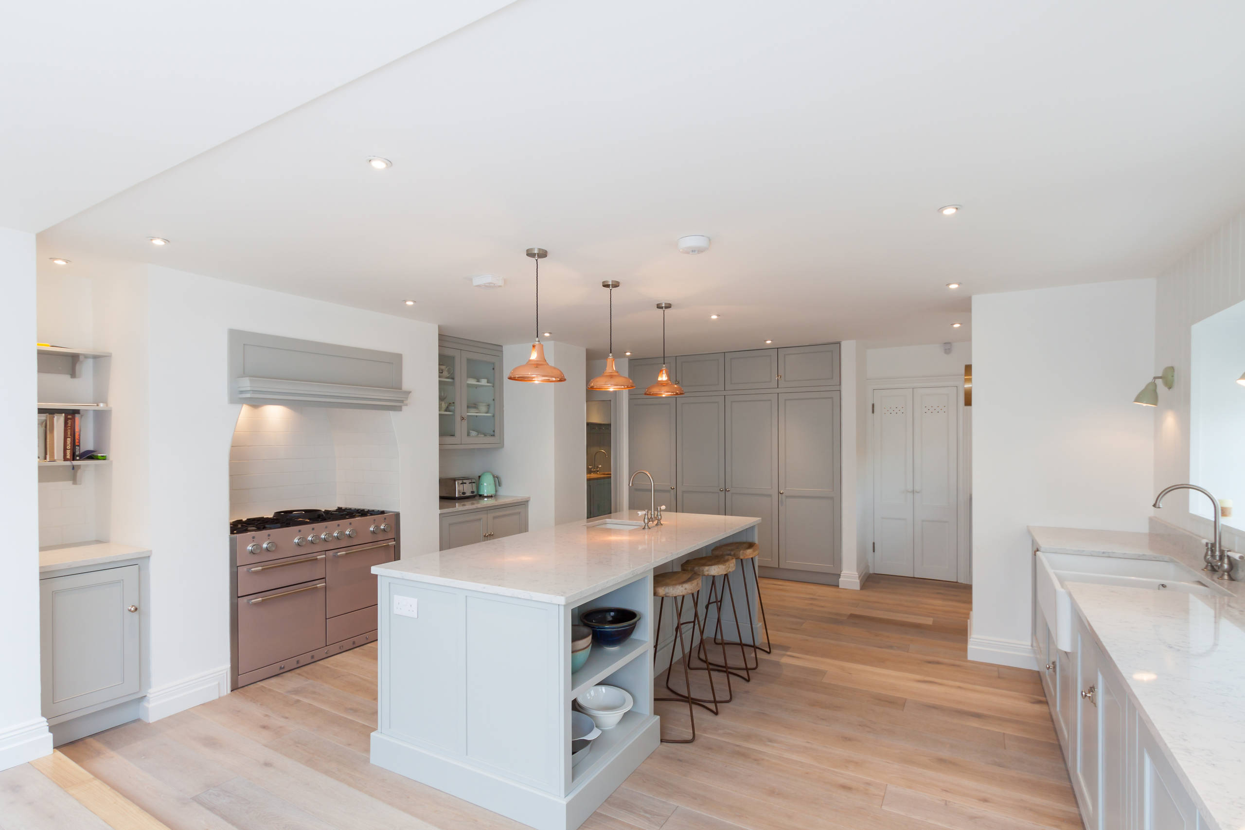 Domestic lighting scheme featuring pendant lights in the kitchen